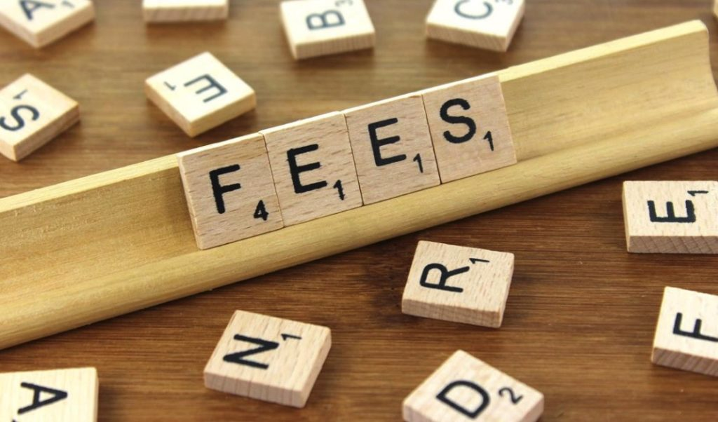 the word fees on Wooden Tiles