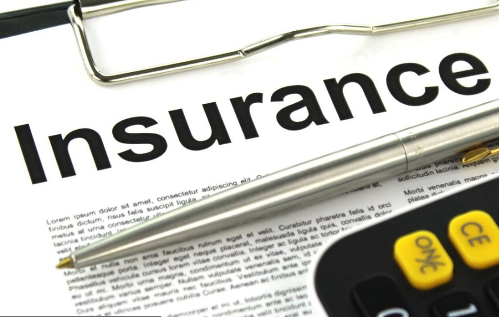 the word insurance on a newspaper